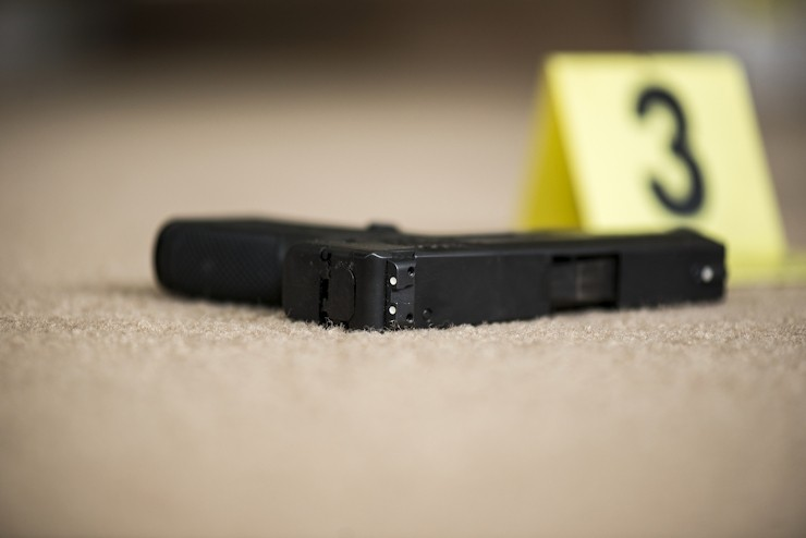crime scene with gun