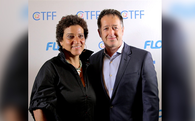 CEO of CaribbeanTales, Frances-Anne Solomon and FLOW's CEO John Reid