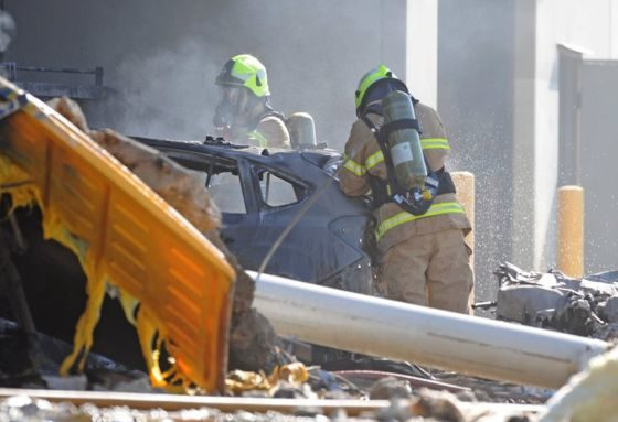 Five dead as plane hits shopping centre