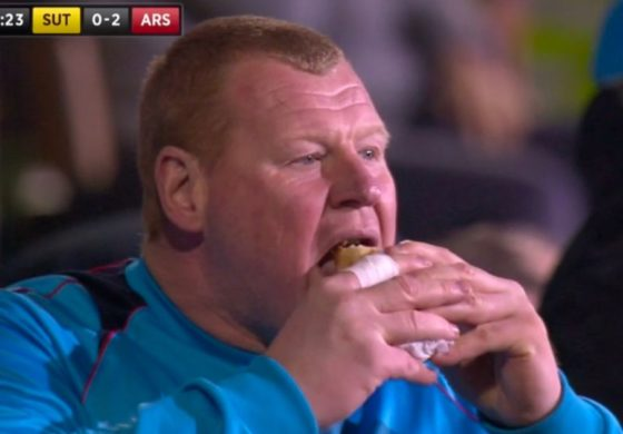 Goalkeeper sacked over eating pie on TV