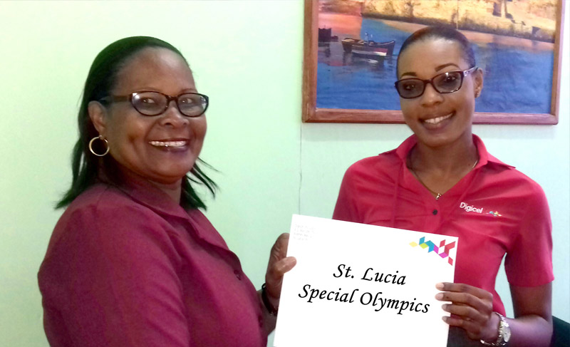Digicel's Marketing and Communications Executive Louise Victor makes presenatation to Assistant Head of Delgation Special Olympics St.Lucia