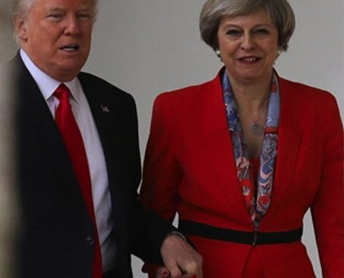 Theresa May says why Donald Trump held her hand