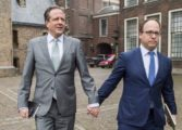 Dutch men hold hands in homophobia protest