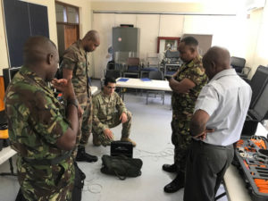 A group from the Explosive Ordnance Disposal Subject Matter Expert Exchange participating in a disarmament exercise