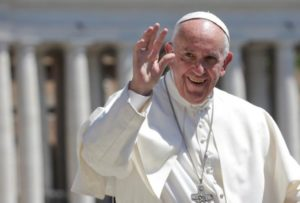 FILE PHOTO: Pope Francis waves as he leads the Wednesday General Audience in Saint Peter's square at the Vatican