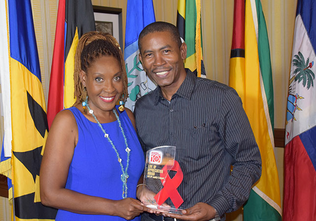 Howard and Mitzi Allen of HAMAFilms Antigua with their LIVE UP Loyalty Support Award from the LIVE UP Caribbean Media Alliance 10th anniversary celebration of Regional Testing Day
