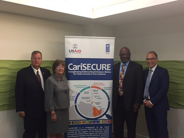 (L-R) USAID Mission Director, Christopher Cushing; U.S. Ambassador to Barbados, the Eastern Caribbean, and the OECS, Linda Taglialatela; Attorney General, and Minister of Home Affairs for Barbados, Adriel Brathwaite; and UN Resident Coordinator and UNDP Resident Representative, Stephen O'Malley