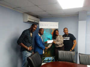 SLTB's Donna Compton Charles presenting cheque to Empire Media S. LeBourne & Artists