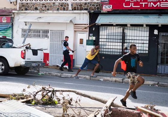 'There are no rules': Desperate tourists tweet out of St Maarten as looters with 'guns & machetes' raid hotel rooms & stores