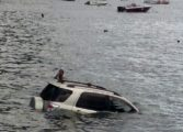 Woman rescued after vehicle plunges into sea