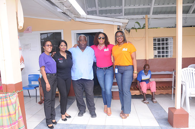 Courts Team along with representative from Lensyl at the St Lucy's home