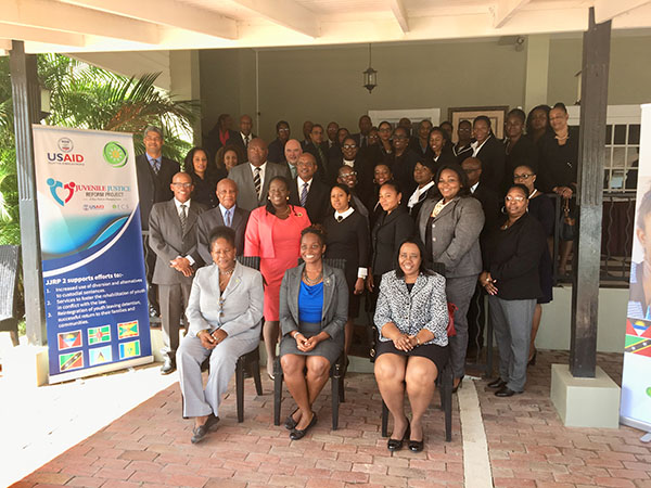 Front row (l-r) : Gloria Augustus, Technical Specialist, JJRP2, OECS Commission; Simone Brown, Education Development Officer, USAID ESC; Her Ladyship Honorable Gertel Thom, Justice of Appeal and Chairman of Judicial Education Institute of the Eastern Caribbean Supreme Court. Also pictured are High Court Judges, and administrative representatives of the Eastern Caribbean Supreme Court, Magistrates of the OECS, OECS Bar Association, and OECS Ministry of Justice representatives.