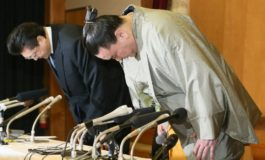 Tearful sumo champion steps down after brutal attack on rival