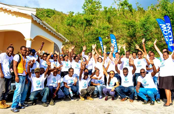Mission Accomplished! C&W CEO John Reid celebrates with members of his executive team and the colleagues of Flow Dominica on the completion of their Mission Day 2017 Volunteer activity in Dominica at CHANCES