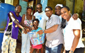 Along with mayor Pius Gangardine, Flow presented a Christmas hamper to this family on upper Church St.