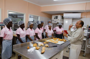 Baker Ali with students from the Vieux Fort Comprehensive Secondary School