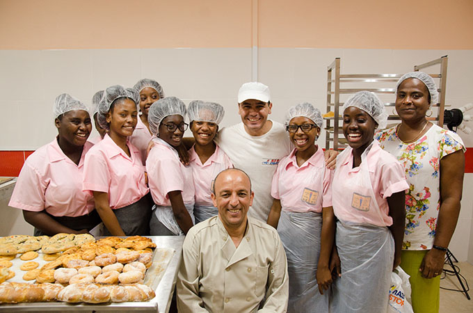 Bakers Michael and Ali with students from Vieux Fort Comprehensive Secondary School