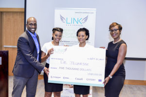 Winners Shenelle and Janelle Hills-Fife of De Jeunesse Bath and Body Products receive their $5,000 cheque from Gerard Thomas LINK-Caribbean Project Officer and Melissa Brathwaite, LINK-Caribbean's Programme Assistant from Caribbean Export.