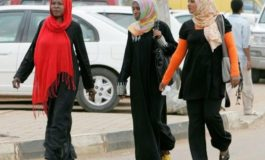 Women charged with indecency for wearing trousers
