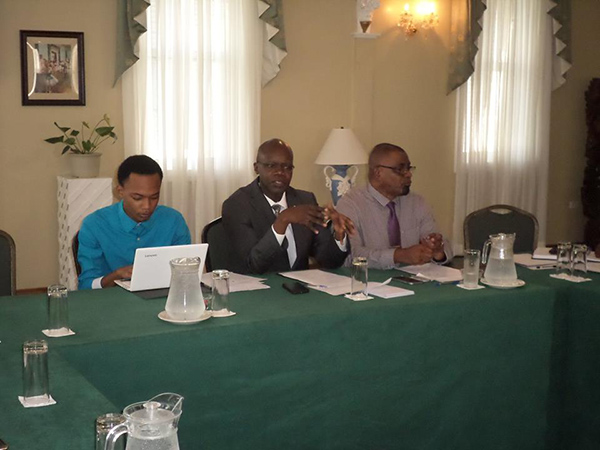 L-R Dennis Glasgow, participant, Dr Martin Odiit, UNAIDS Country Director, Guyana and Suriname and Mr Dereck Springer, Director of PANCAP