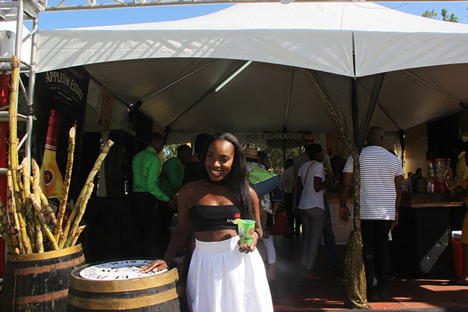 One of the PCD Brand Ambassadors welcomes patrons to the PCD experience lounge
