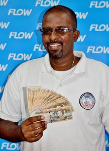 Soufriere Comprehensive mathematics teacher Zial Williams will be counting up his $2000 winnings from Flow!