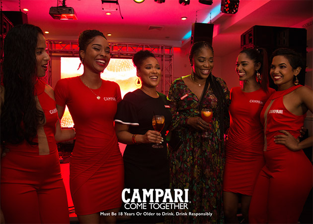 Stunning Campari Girls flank Regional Commercial Director Michelle Brown (left) and Trade Marketing Manager Rowena Anderson (right) at Campari's Trinidad Launch