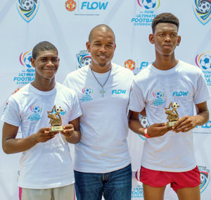 Winners, Jeremiah and Djal with Flow Saint Lucia Acting Marketing Manager, Terry Finisterre