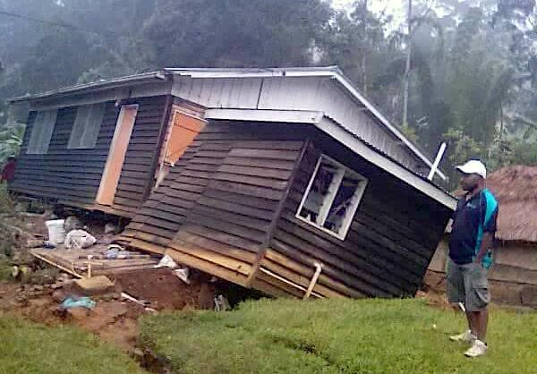 A local stands next to a damaged house near a landslide in the town of Tari after an earthquake struck Papua New Guinea's Southern Highlands in this image taken February 27, 2018 obtained from social media. Francis Ambrose