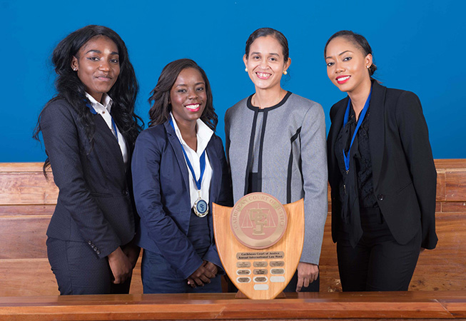 The winning team of Ms. Janessa Murray (left), Ms. Megan Curry (2nd left), Ms. Raven Rolle (right), with advisor Ms. Raquel Williams (2nd from right), clinched the fifth victory for the Eugene Dupuch Law School of the Bahamas in the 9th Annual Caribbean Court of Justice International Law Moot Competition.