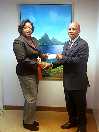 Saint Lucia's Permanent Representative to the United Nations, His Excellency Cosmos Richardson, presented a cheque in the amount of USD1000 to Dominica's Permanent Representative, Her Excellency Loreen Bannis-Roberts, on behalf of the Saint Lucian American Association of Connecticut (SLAAC).