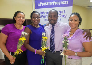 Flow commercial lead Anselm Mathurin with the women of the marketing team on International Wome's Day