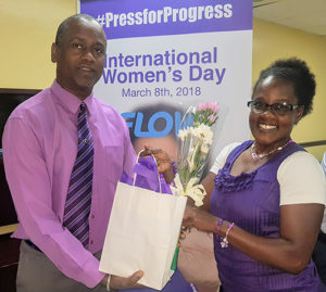 Flow country manager V. Chris Williams presented tokens of appreciation to all of the company's female employees on International Women's Day 2018