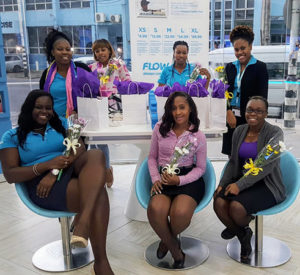 The ladies of Flow Dayana Centre posing with their tokens of appreciation on International Women's Day 2018