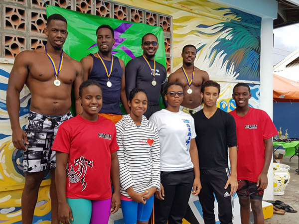 LUCELEC Club pose with a few St Lucia National Swimmers