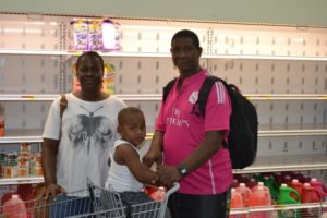 Maritza Crogman, beneficiary of the Voucher Programme shopping with her family