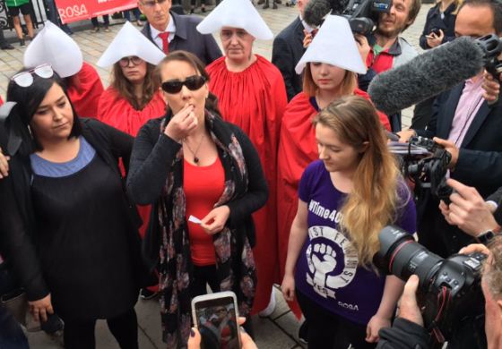 Women swallow abortion pills at pro-choice protest