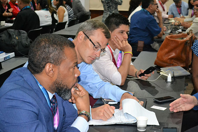 Mr. R Jackson facilitating group discussion at the Bill and Melinda Gates Foundation side event