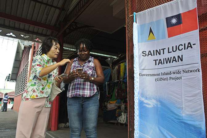 Taiwanese project manager, Karen Kuo explain the GiNet WIFI service to local people