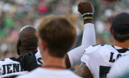 NFL players protest during US national anthem