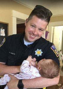 Police officer adopts child daughter of homeless lady
