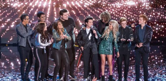 """""""American Idol"""" Season 17 winner Laine Hardy sings his coronation song, """"Flame,"""" surrounded by his fellow contestants and mentor Bobby Bones."""