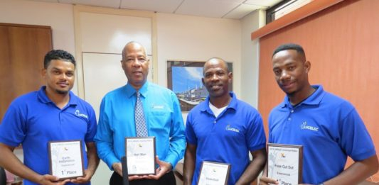 LUCELEC Managing Director Trevor Louisy with the company's Apprentice Team (FROM LEFT) Sherick Anthony, Nerie Joseph and Godwin Brice